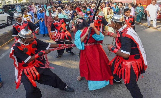 Christian devotees re-enact the crucifixion of Lord Jesus to observe Good Friday in Patna, Friday, April 19, 2019. Christians observe Good Friday to mark the crucifixion of Lord Jesus. (PTI Photo)