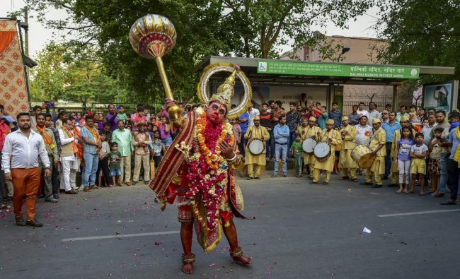 An artist dressed as Lord Hanuman takes part in a religious procession on the occasion of Hanuman Jayanti, in New Delhi, Friday, April 19, 2019. (PTI Photo/Arun Sharma)