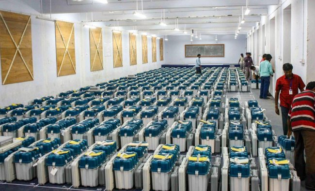 Electronic Voting Machine (EVM) being lined up and stored inside a college following the second phase of the Lok Sabha elections, in Coimbatore, Friday, April 19, 2019. (PTI Photo)