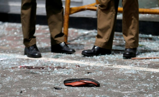 A shoe of a victim is seen in front of the St. Anthony\'s Shrine, Kochchikade church after an explosion in Colombo, Sri Lanka April 21, 2019. REUTERS/Dinuka Liyanawatte