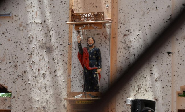 A statue of St. James is pictured after a bomb blast inside a church in Negombo, Sri Lanka April 21, 2019. REUTERS/Stringer
