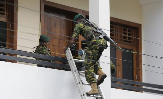 A Sri Lankan police commando enters a house suspected to be a hideout of militants following a shoot out in Colombo, Sri Lanka, Sunday, April 21, 2019. More than hundred were killed and hundreds more hospitalized with injuries from eight blasts that rocked churches and hotels in and just outside of Sri Lanka\'s capital on Easter Sunday, officials said, the worst violence to hit the South Asian country since its civil war ended a decade ago. AP/PTI