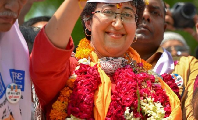 Aam Aadmi Party\'s (AAP) candidate from East Delhi, Atishi, shows victory sign on her way to file nomination papers for the Lok Sabha elections, in New Delhi, Monday, April 22, 2019. (PTI Photo/ Kamal Kishore)