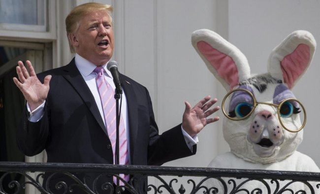 US President Donald Trump and the Easter Bunny wave during the annual White House Easter Egg Roll on the South Lawn of the White House in Washington, DC on April 22, 2019.
