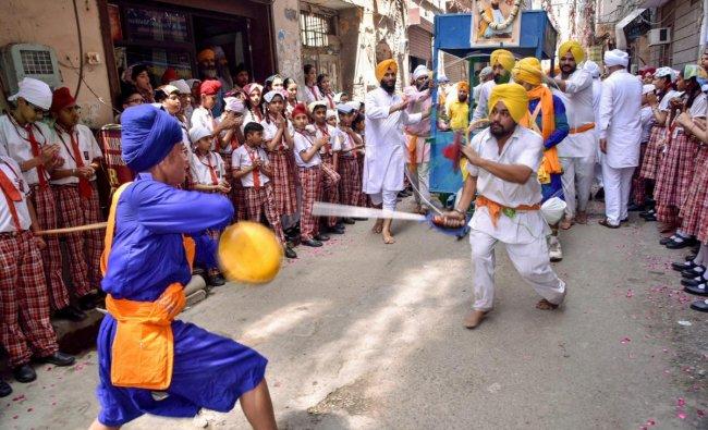 Amritsar: Sikh devotees participate in a \'Nagar Kirtan\' procession to mark the birth anniversary of Guru Tegh Bahadur, the ninth of the ten gurus of Sikhism, in Amritsar, Tuesday, April 23, 2019. (PTI Photo)