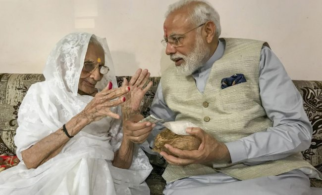Prime Minister Narendra Modi being blessed by his nonagenarian mother Hiraba as he meets her before casting his vote, during the third phase of the 2019 Lok Sabha elections, in Gandhinagar, Tuesday, April 23, 2019. (PTI Photo)