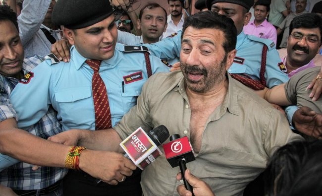 Actor Sunny Deol talks to the media as he leaves the BJP headquarter after joining the party, in New Delhi, Tuesday, April 23, 2019. (PTI Photo)