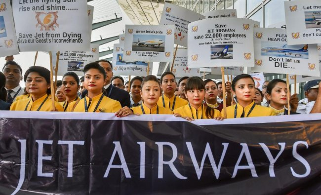 et Airways employees display placards as they gather to make an appeal for saving the cash-starved airline following the temporary shutdown of its operations, at NSCBI Airport in Kolkata, Wednesday, April 24, 2019. PTI Photo/Ashok Bhaumik)