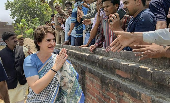 Congress General Secretary Priyanka Gandhi Vadra meets her supporters during an election campaign for Lok Sabha elections, Fatehpur district of UP, Wednesday, April 24, 2019. (PTI Photo)