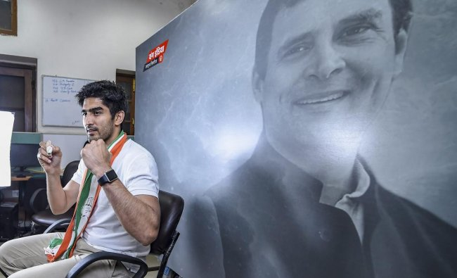 Boxer and Congress candidate from South Delhi constituency Vijender Singh poses for photograph at Youth Congress office, ahead of the Lok Sabha polls in New Delhi, Wednesday, April 24, 2019. (PTI Photo/Atul Yadav)