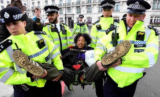 Members of the police carry a demonstrator during the Extinction Rebellion protest at the Marble Arch in London, Britain April 24, 2019. REUTERS/Toby Melville