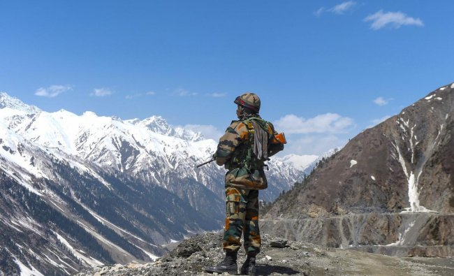 An army soldier stands guard at Zojila Pass, situated at a height of 11,516 feet, on its way to frontier region of Ladakh. (PTI Photo)