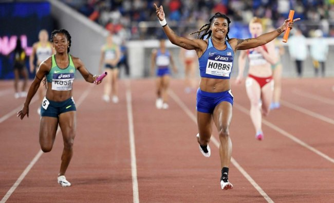 Aleia Hobbs of the U.S., right, crosses the finish line, winning the 4x100 meters women\'s relay final at the IAAF World Relays Sunday, May 12, 2019, in Yokohama, Japan. At left is Vitoria Cristina Rosa of Brazil. AP/PTI