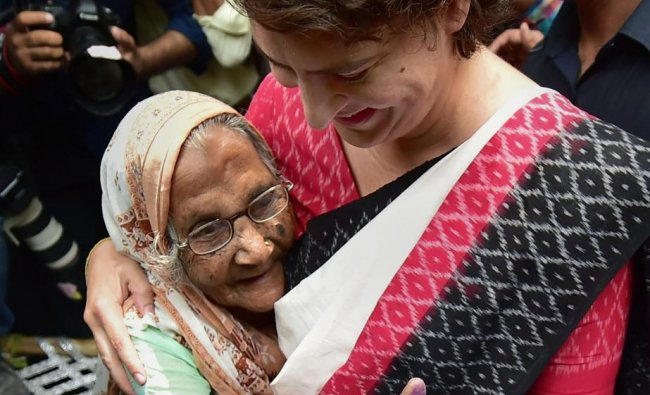 Congress General Secretary Priyanka Gandhi Vadra hugs an elderly voter after casting vote for the sixth phase of Lok Sabha elections, at polling station at Lodhi road in New Delhi, Sunday, May 12, 2019. (PTI Photo)