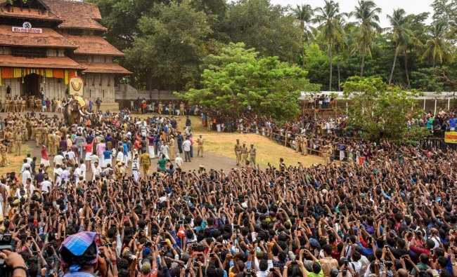 Devotees gather as elephant Thechikottukavu Ramachandran arrives to open the doors of the southern Gopuram of the Vadakkumnathan temple to formally begin the Thrissur Pooram festival, in Thrissur, Sunday, May 12, 2019. (PTI Photo)