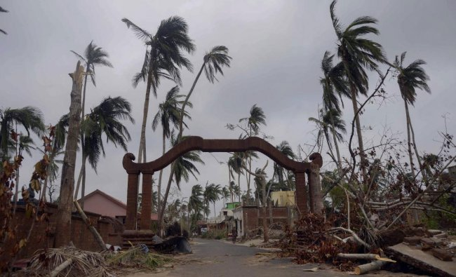 Damaged structure and uprooted trees are seen in the aftermath of cyclone \'Fani\', at Amphi Theatre, Raghurajpur village, in Puri district, Friday, May 10, 2019. (PTI Photo)