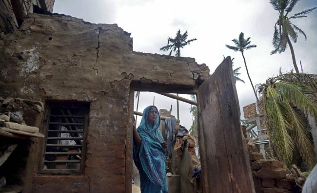 A woman stands in the remnants of her home in the aftermath of cyclone \'Fani\', at the heritage crafts village Raghurajpur, in Puri district, Friday, May 10, 2019. (PTI Photo)
