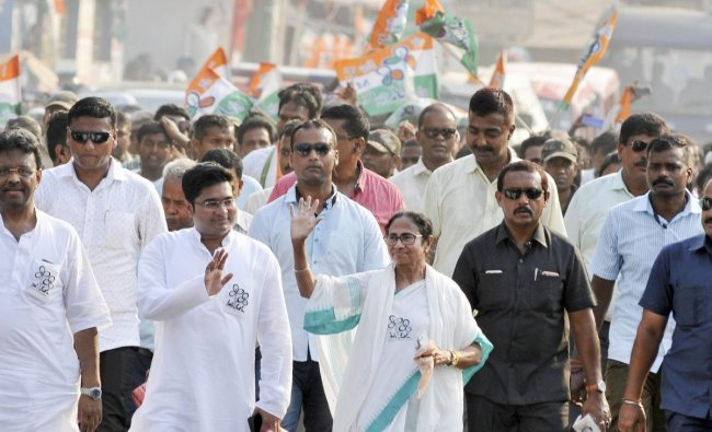 West Bengal Chief Minister and Trinamool Congress supremo Mamata Banerjee waves at the crowd during an election roadshow rally in favour of her nephew and party candidate from Diamond Harbour Abhishekh Banerjee (L), ahead of the last phase of Lok Sabha polls, in Kolkata, Monday, May 13, 2019. (PTI Photo)