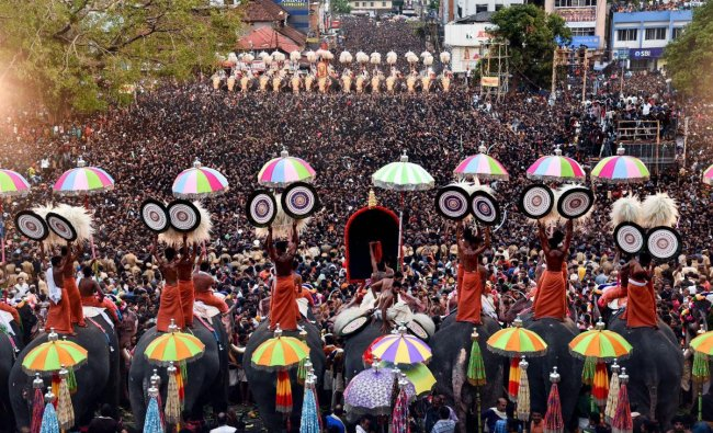 Devotees witness umbrella showing competition by Thiruvambadi and Paramekkavu Devaswams in connection with the famous \'Thrissur Pooram\', Monday, May 13, 2019. (PTI Photo)