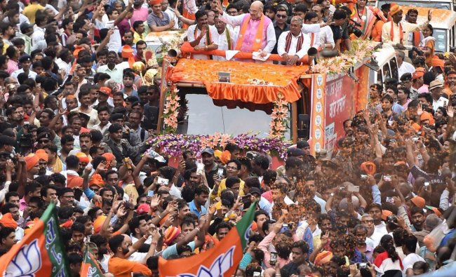 BJP National President Amit Shah during a roadshow for the last phase of Lok Sabha elections 2019, in Kolkata, Tuesday, May 14, 2019. (PTI Photo)