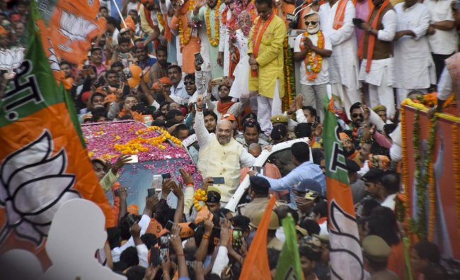 BJP National President Amit Shah along during an election campaign roadshow for the seventh and last phase of Lok Sabha polls, in Gorakhpur, Thursday, May 16, 2019. (PTI Photo)