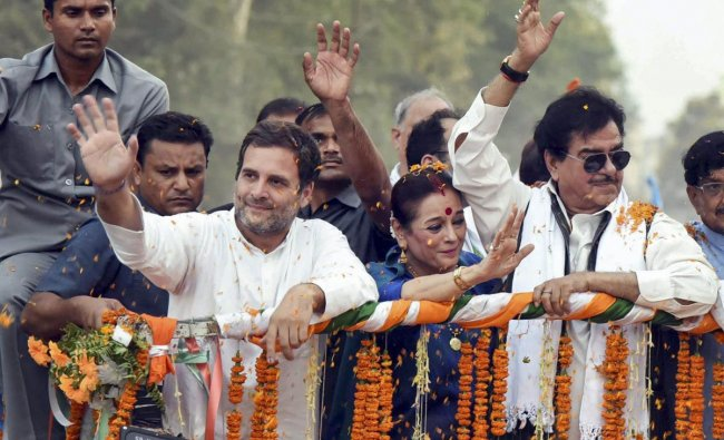 Congress President Rahul Gandhi with party\'s Patna Sahib candidate Shatrughan Sinha and Samajwadi candidate from Lucknow Poonam Sinha during a roadshow for the final phase of Lok Sabha polls, in Patna, Thursday May 16, 2019. (PTI Photo)