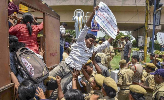 Hyderabad: Writers and activists being detained as they demand for the release of social activist Saibaba and revolutionary writer Varavara Rao during a protest, in Hyderabad, Friday, May 17, 2019. PTI