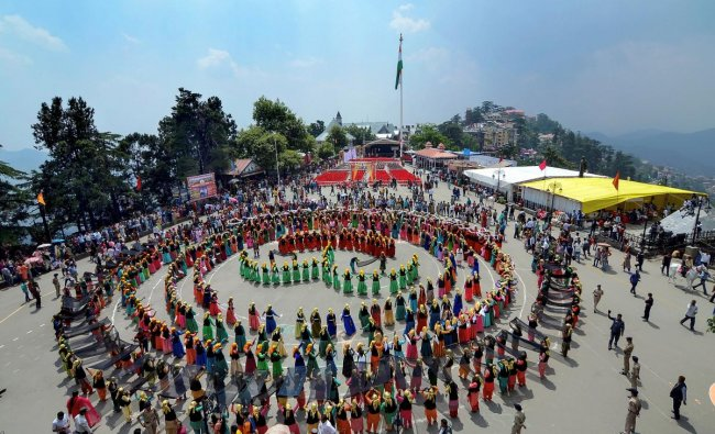 Anganwadi workers perform Naati dance during a rally to create awareness on saving \'girl child\' on the first day of the Shimla Summer Festival 2019 at Ridge in Shimla. (PTI Photo)