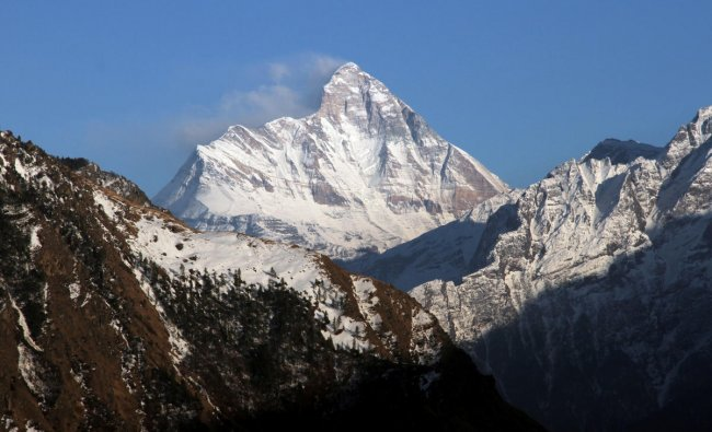 Snow-covered Nanda Devi mountain is seen from Auli town, in Uttarakhand. (Reuters Photo)