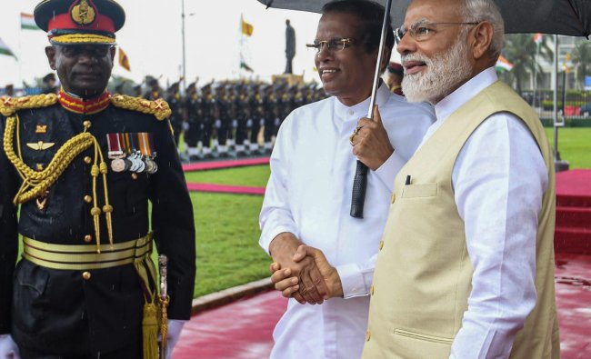 Prime Minister Narendra Modi shakes hands with Sri Lankan President Maithripala Sirisena at a ceremonial reception, in Colombo, Sunday, June 09, 2019. (PTI Photo)