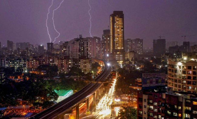 Bolts of lightning flash across the sky during thunderstorm and rain over the suburbs, in Mumbai, late Monday, June 10, 2019. (PTI Photo/Neel Geelani)
