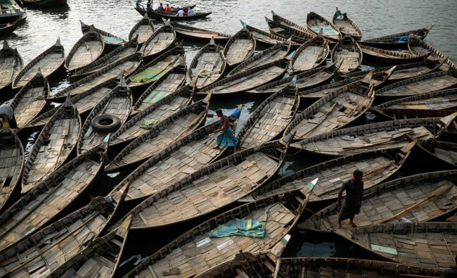 Boats are anchored at the bank of the river Buriganga which are used to carry passengers crossing the river in Dhaka, Bangladesh, June 12, 2019. REUTERS/Mohammad Ponir Hossain