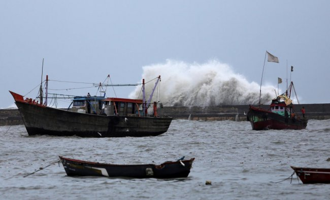 Waves crash against the jetty at a fishing harbour ahead of the expected landfall of Cyclone Vayu at Veraval, India, June 12, 2019. REUTERS/Amit Dave