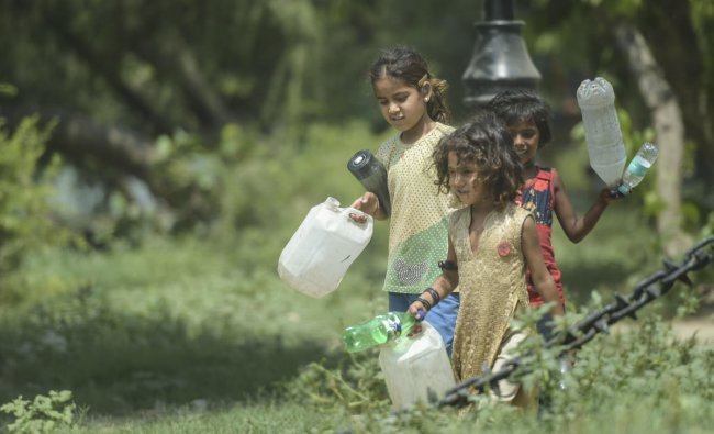 Children on their way to collect water on a hot summer day, in New Delhi, Wednesday, June 12, 2019. (PTI Photo/Vijay Verma)