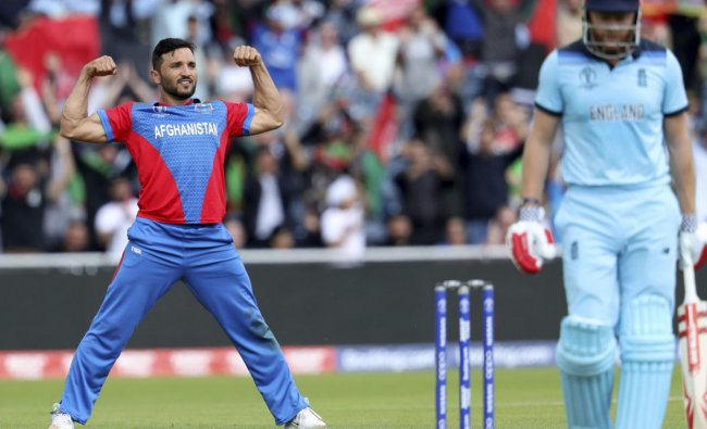 Afghanistan\'s captain Gulbadin Naib, left, celebrates the dismissal of England\'s Jonny Bairstow, right, during the Cricket World Cup match between England and Afghanistan at Old Trafford in Manchester, England, Tuesday, June 18, 2019. AP/PTI