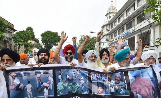 Members of the Sikh community participate in a protest rally against the attack by Delhi Police on a \'Gramin Sewa\' tempo driver yesterday, in Kolkata, Tuesday, June 18, 2019. PTI