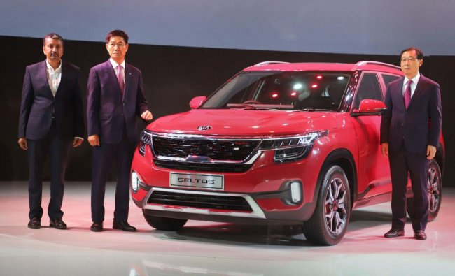 President and CEO of Kia Motors Corporation Han Wu Park, Managing Director Kia Motors India Kookhyun Shim and Vice President & Head of Sales and Marketing, Manohar Bhat, during the launch of Kia Seltos SUV, in Gurugram, Thursday, June 20, 2019. PTI