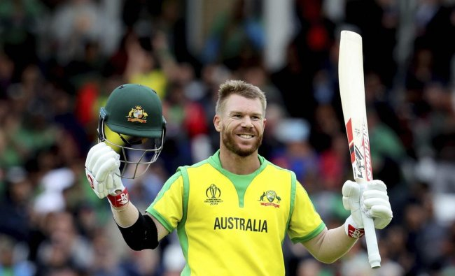 Australia\'s David Warner raises his bat and helmet to celebrate scoring a century during the Cricket World Cup match between Australia and Bangladesh at Trent Bridge in Nottingham, Thursday, June 20, 2019. AP/PTI