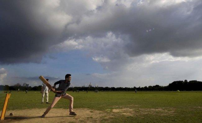 Boys play cricket during a cloudy weather at Kolkata Maidan in Kolkata, Sunday, June 23, 2019. (PTI Photo)