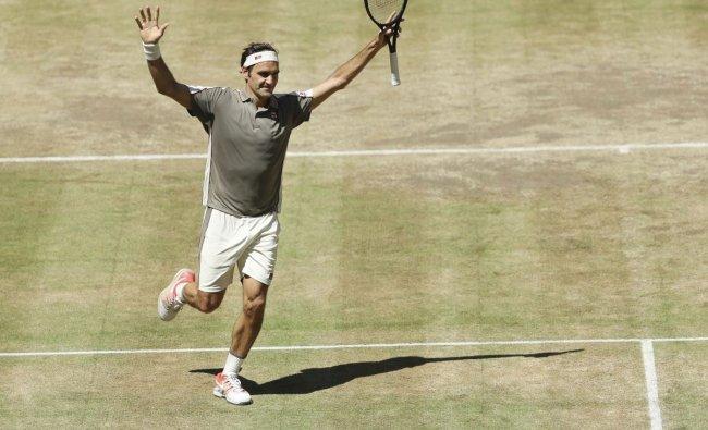 Roger Federer celebrates after winning the tennis ATP final against Belgium David Goffin in Halle, Germany, Sunday, June 23, 2019. AP/PTI