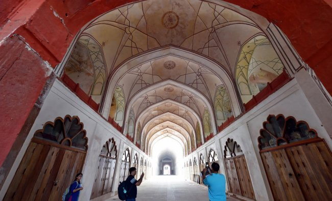 Media persons take photographs of the Red Fort entrance during its ongoing restoration and conservation work, in New Delhi, Monday, June 24, 2019. (PTI Photo)