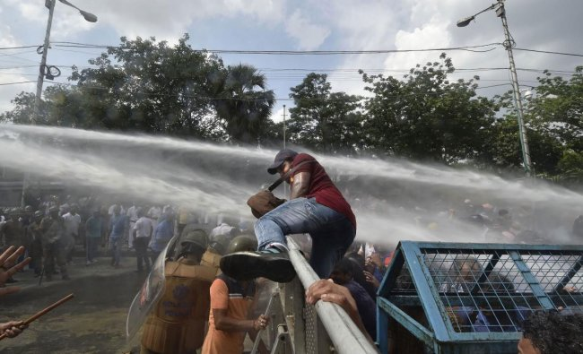 Police uses water cannon to disperse the government primary teachers protesting against the state government demanding the revival of their salaries, in Kolkata, Monday, June 24, 2019. (PTI Photo)