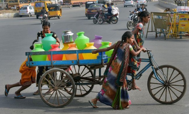 Women push a cart containing vessels filled with water from a tanker following an acute water shortage, in Chennai, Wednesday, June 26, 2019. (PTI Photo)