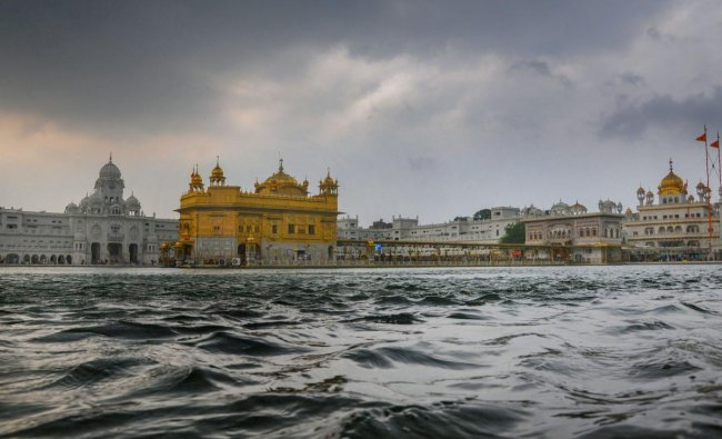 Rain clouds hover over Harmandir Sahib (Golden Temple) ahead of the onset of monsoon, in Amritsar, Thursday, July 4, 2019. (PTI Photo)