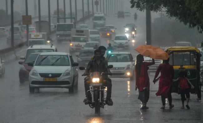 Commuters travel during heavy pre-monsoon rainfall, in Noida, Friday, July 5, 2019. (PTI Photo)