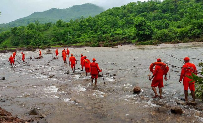 NDRF personnel conduct search operation for missing villagers, after Tiware dam breached following incessant rains, in Ratnagiri, Thursday, July 4, 2019. (PTI Photo)
