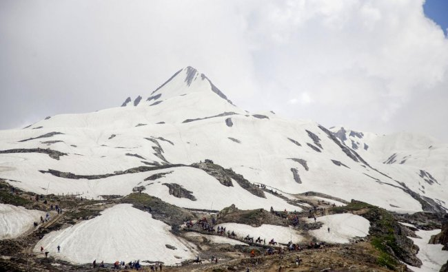 Devotees on their way to the holy cave shrine of Amarnath, near Mahagunas Top in Anantnag district of Jammu and Kashmir. (PTI Photo)
