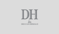 The first set of \'electric buses\' ply on the Boulevard Road at the banks of Dal Lake after its inauguration by Union Minister for Heavy Industries and Public Enterprises Arvind Ganpat Sawant and Governor of Jammu and Kashmir Satya Pal Malik, in Srinagar. (PTI Photo)