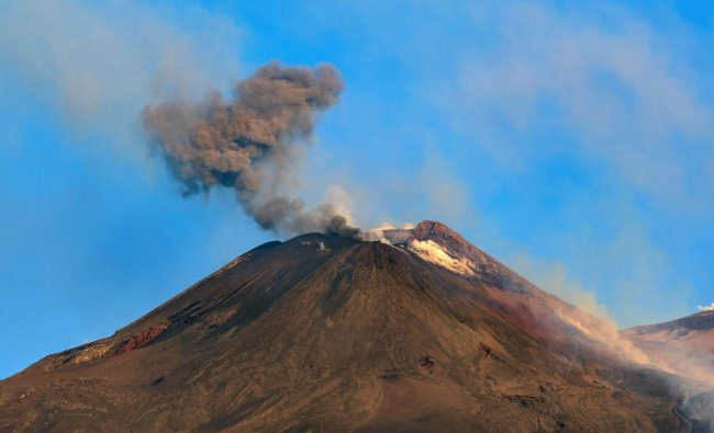 Smoke billows from Mount Etna volcano, the largest of Italy\'s three active volcanoes, near the Sicilian town of Catania, southern Italy. (AP/PTI Photo)