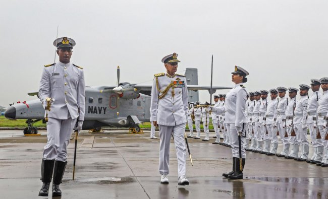 Naval Chief Admiral Karambir Singh inspects a parade during the commissioning of fifth Dornier squadron of the Indian Navy- INAS 313 (Indian Naval Air Squadron 313) at the Naval Air Enclave at Meenambakkam, in Chennai. (PTI Photo)
